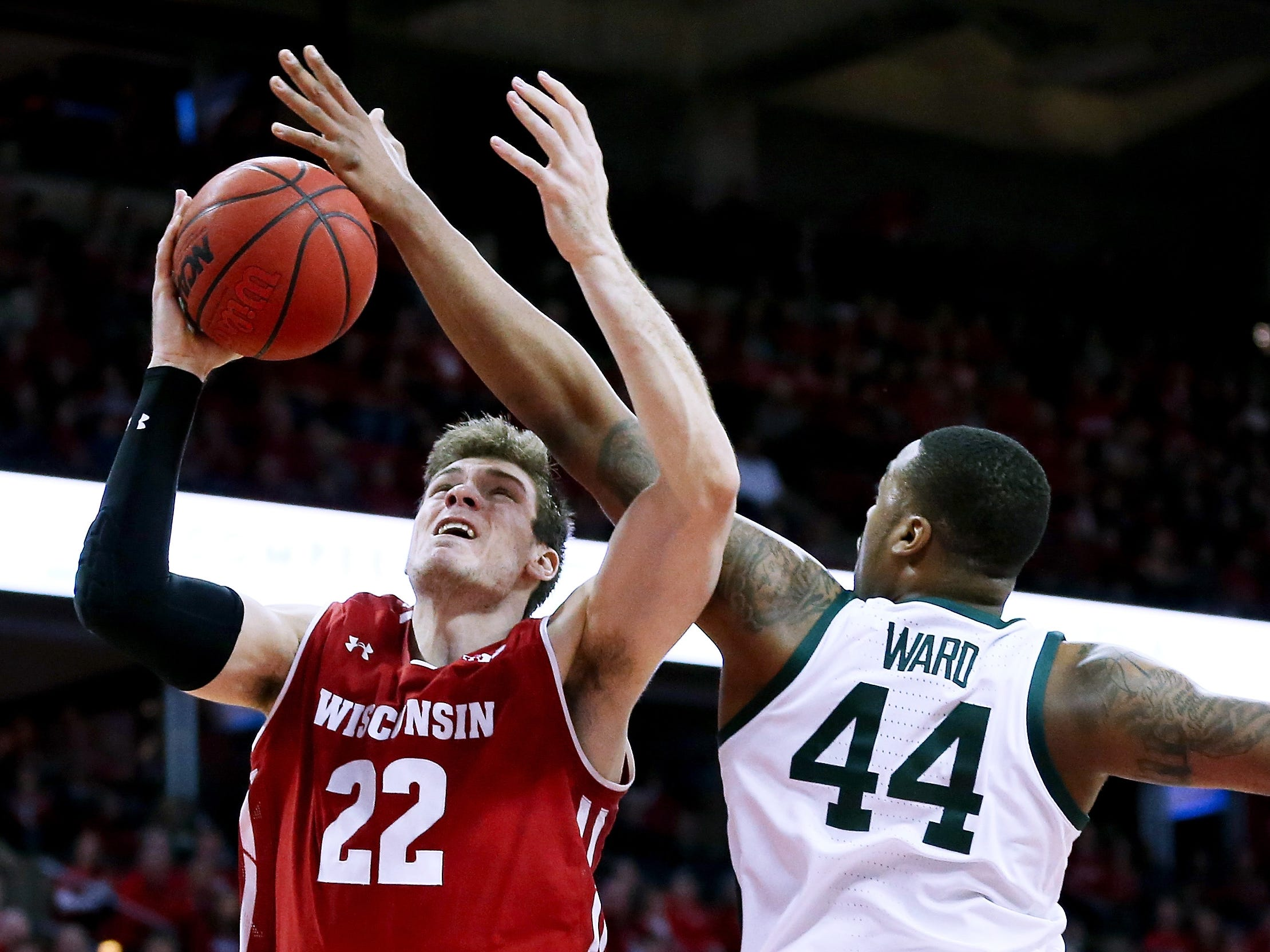 Nick Ward #44 of the Michigan State Spartans blocks a shot attempt by Ethan Happ #22 of the Wisconsin Badgers in the first half at the Kohl Center on February 12, 2019 in Madison, Wisconsin.