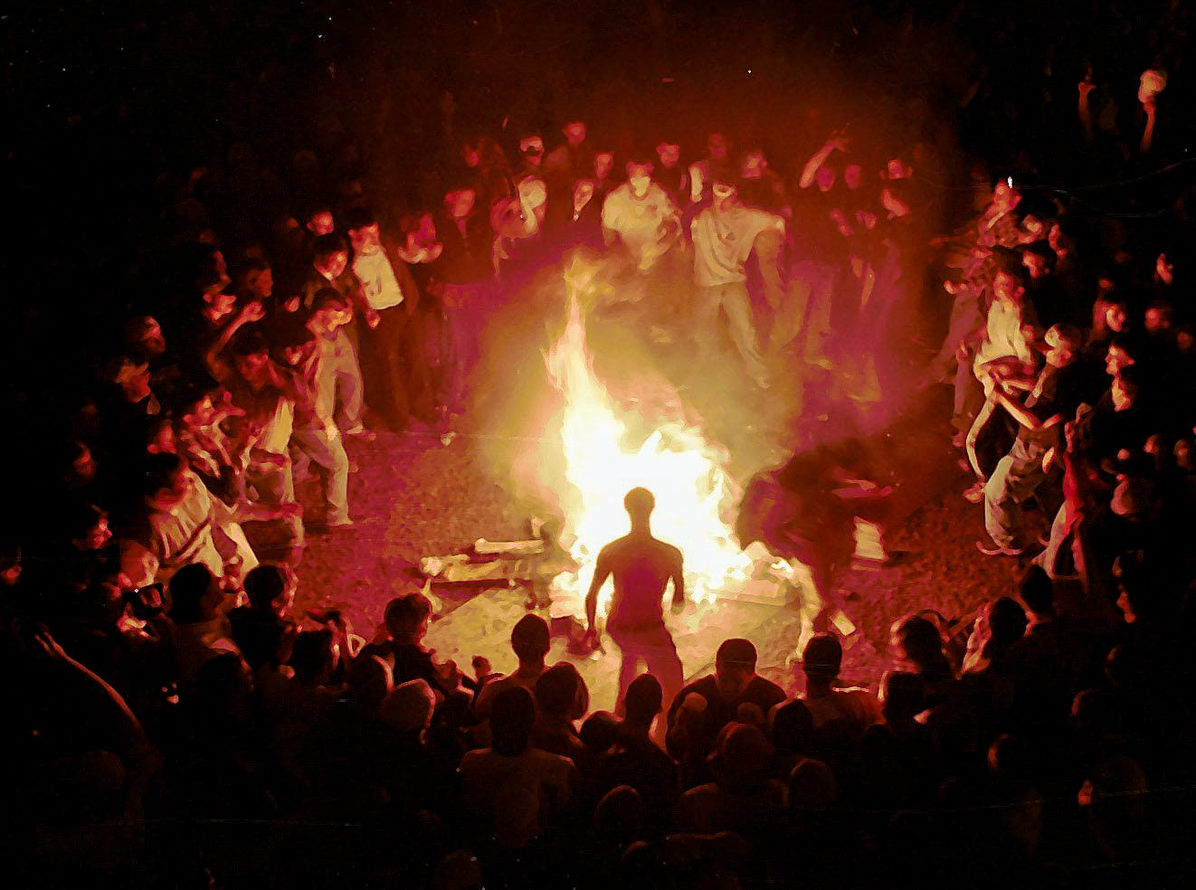 A man prepares to jump over a bonfire in Cedar Village on Saturday, March 27, 1999, in East Lansing.