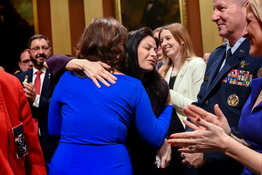 Michigan Gov. Gretchen Whitmer, left, hugs Michigan Attorney General Dana Nessel, right, before Whitmer delivers her State of the State address on Tuesday, Feb. 12, 2019, at the Michigan State Capitol in Lansing.