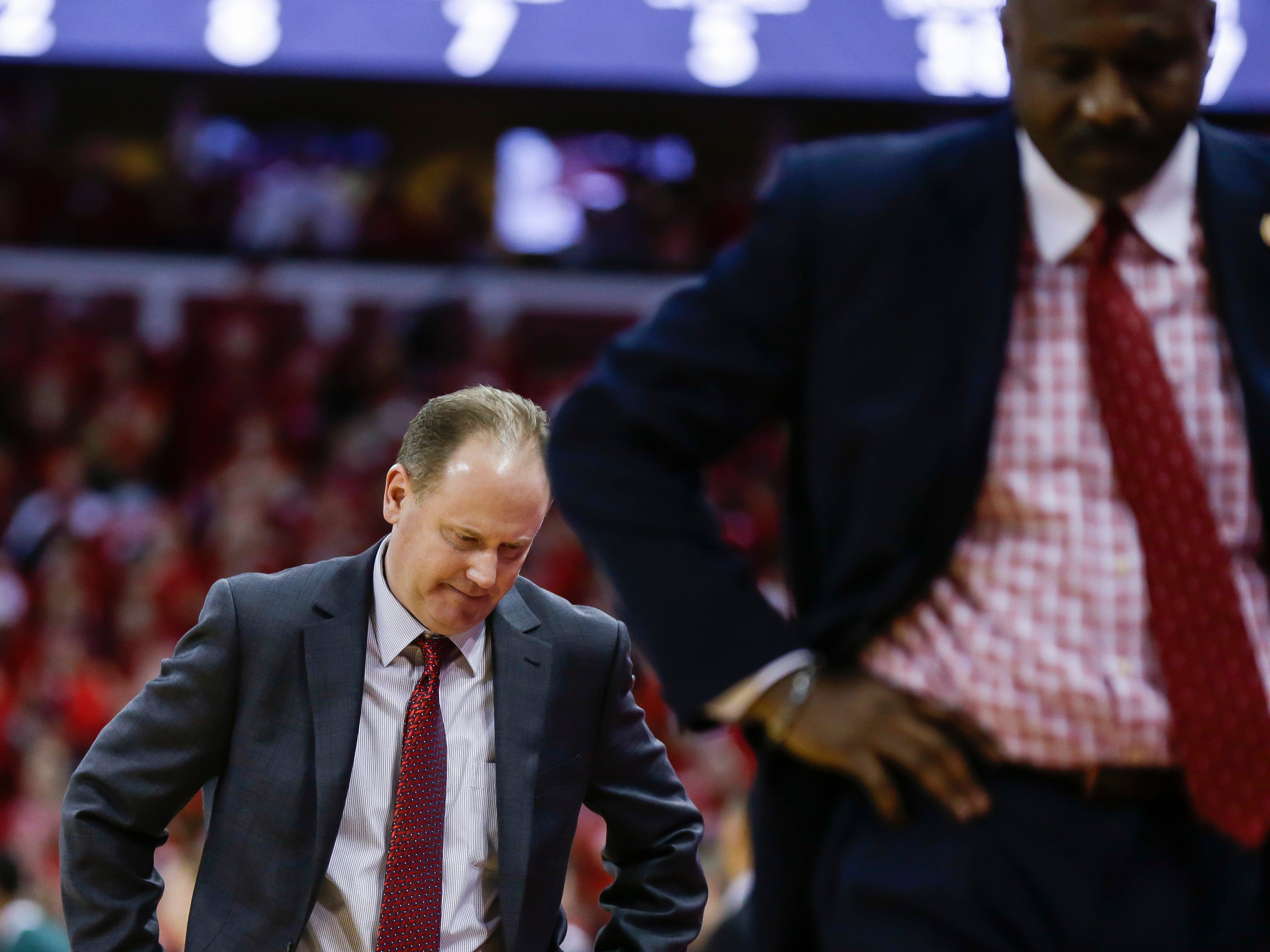 Wisconsin coach Greg Gard, left, and assistant coach Howard Moore pace the floor during the second half of Wisconsin's 67-59 loss to Michigan State in an NCAA college basketball game Tuesday, Feb. 12, 2019, in Madison, Wis.