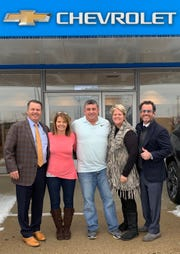 From right, Tony Young, former Bees Chevrolet owners Barb and Jeff Feldpauch, Lori Young and Skip Young pose in front of the Bees Chevrolet of St. Johns dealership.