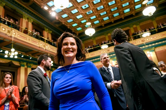 Michigan Gov. Gretchen Whitmer walks to the rostrum before delivering her State of the State address on Tuesday, Feb. 12, 2019, at the Michigan State Capitol in Lansing.