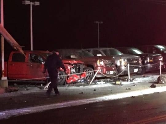 Several pickup trucks at the Graham Automall lot on Home Road were damaged in an early Wednesday morning one-vehicle, fatal crash.
