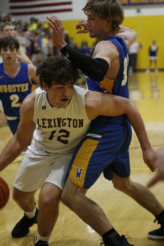Lexington's Ben Vore drives around Wooster's Jett Morgan in Tuesday's 71-44 victory.