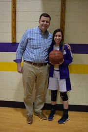 Temple Christian's Jenna Wolford poses with her head coach Paul Baird after scoring her 1,000th-career point last week.