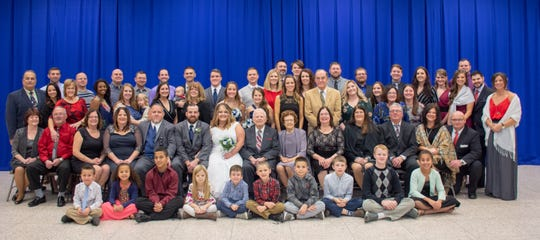 Most of the Bishop Family sit together during a reunion Dec. 1, 2018.