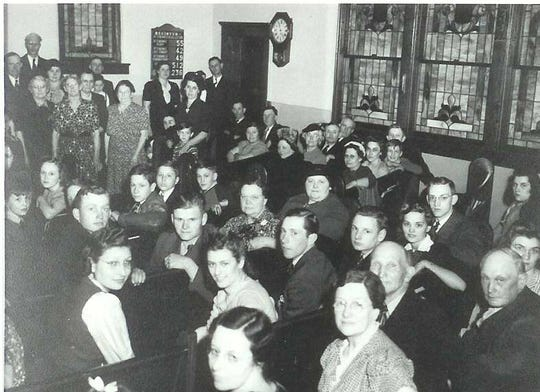 A picture of the last service at Liken's Church before the land it sat on was seized by the United State's Military in 1942.
