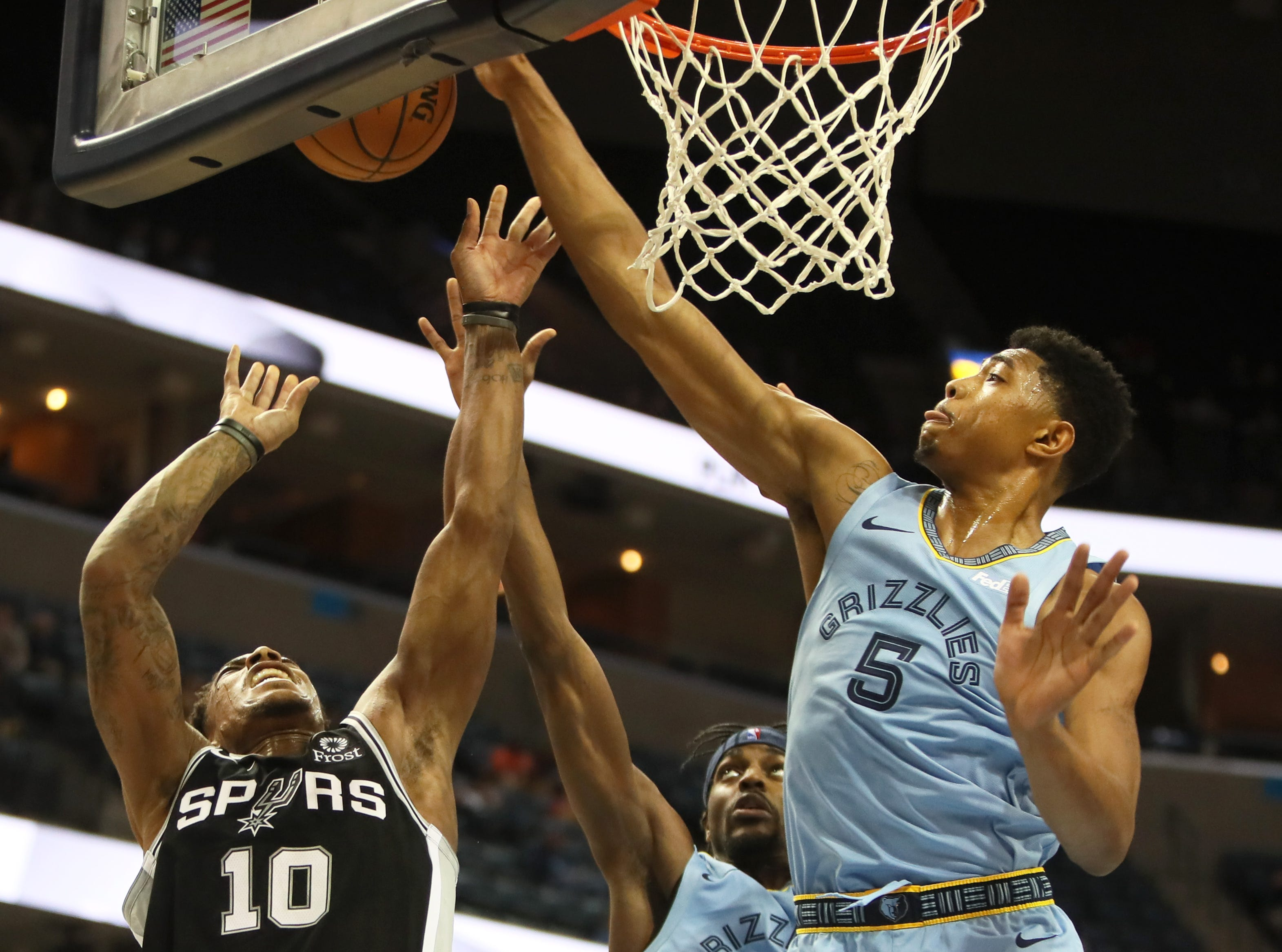 Memphis Grizzlies forward Bruno Caboclo bloacks a shot by San Antonio Spurs guard DeMar DeRozan during their game at the FedExForum on Tuesday, Feb. 12, 2019.