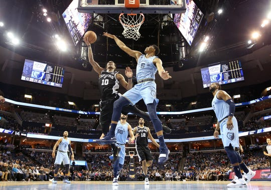Memphis Grizzlies forward Bruno Caboclo defends a shot by San Antonio Spurs guard DeMar DeRozan during their game at the FedExForum on Tuesday, Feb. 12, 2019.