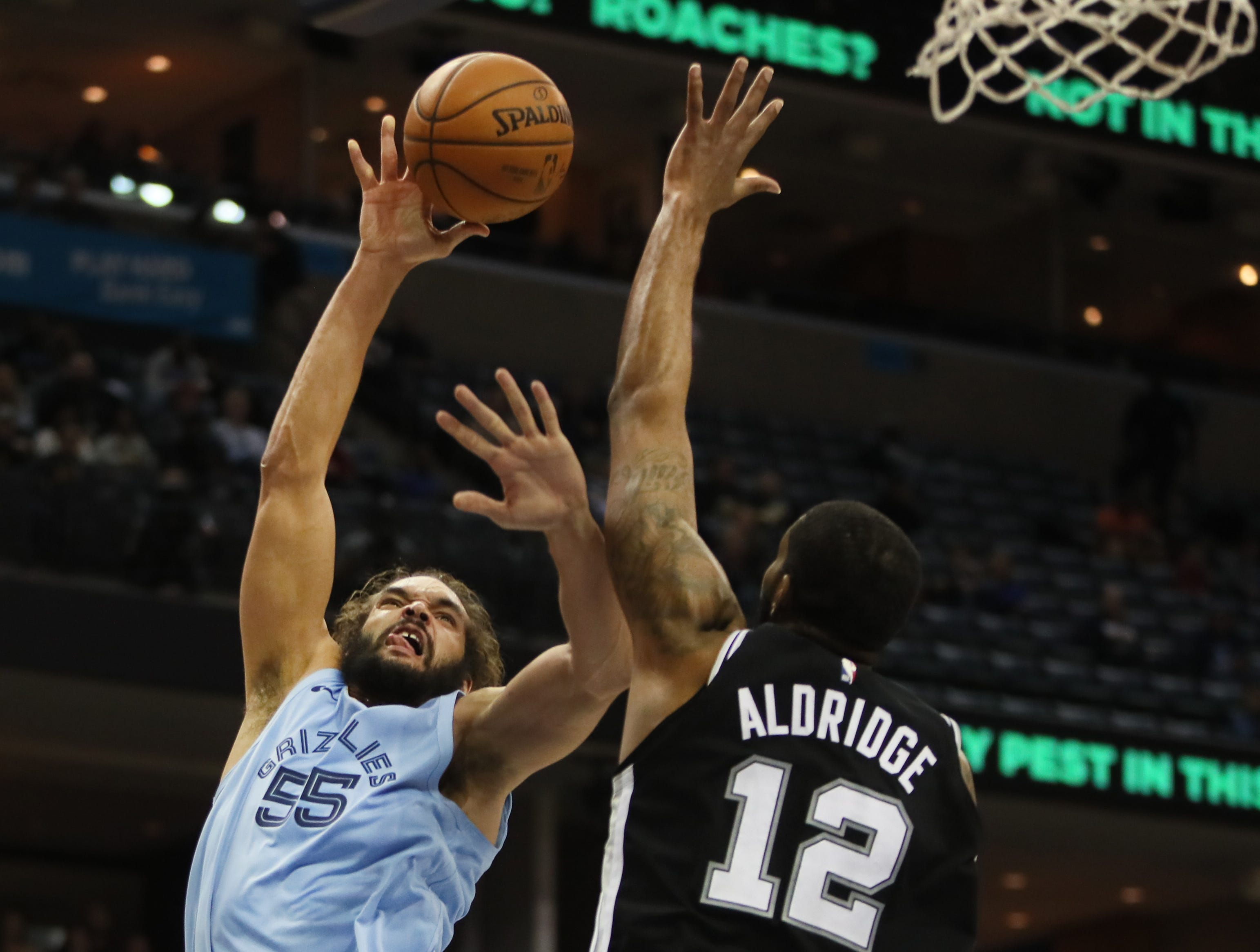 Memphis Grizzlies forward Joakim Noah shooots the ball over San Antonio Spurs center LaMarcus Aldridge during their game at the FedExForum on Tuesday, Feb. 12, 2019.