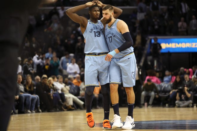 Memphis Grizzlies center Jonas Valanciunas consoles Jaren Jackson Jr. after he missed a free throw that would have sent the game to overtime against the San Antonio Spurs at the FedExForum on Tuesday, Feb. 12, 2019.