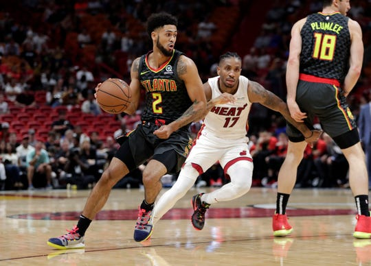 Atlanta Hawks' Tyler Dorsey (2) goes down the court as Miami Heat's Rodney McGruder (17) defends during the second half of a preseason NBA basketball game, Friday, Oct. 12, 2018, in Miami. The Heat won 119-113. (AP Photo/Lynne Sladky)