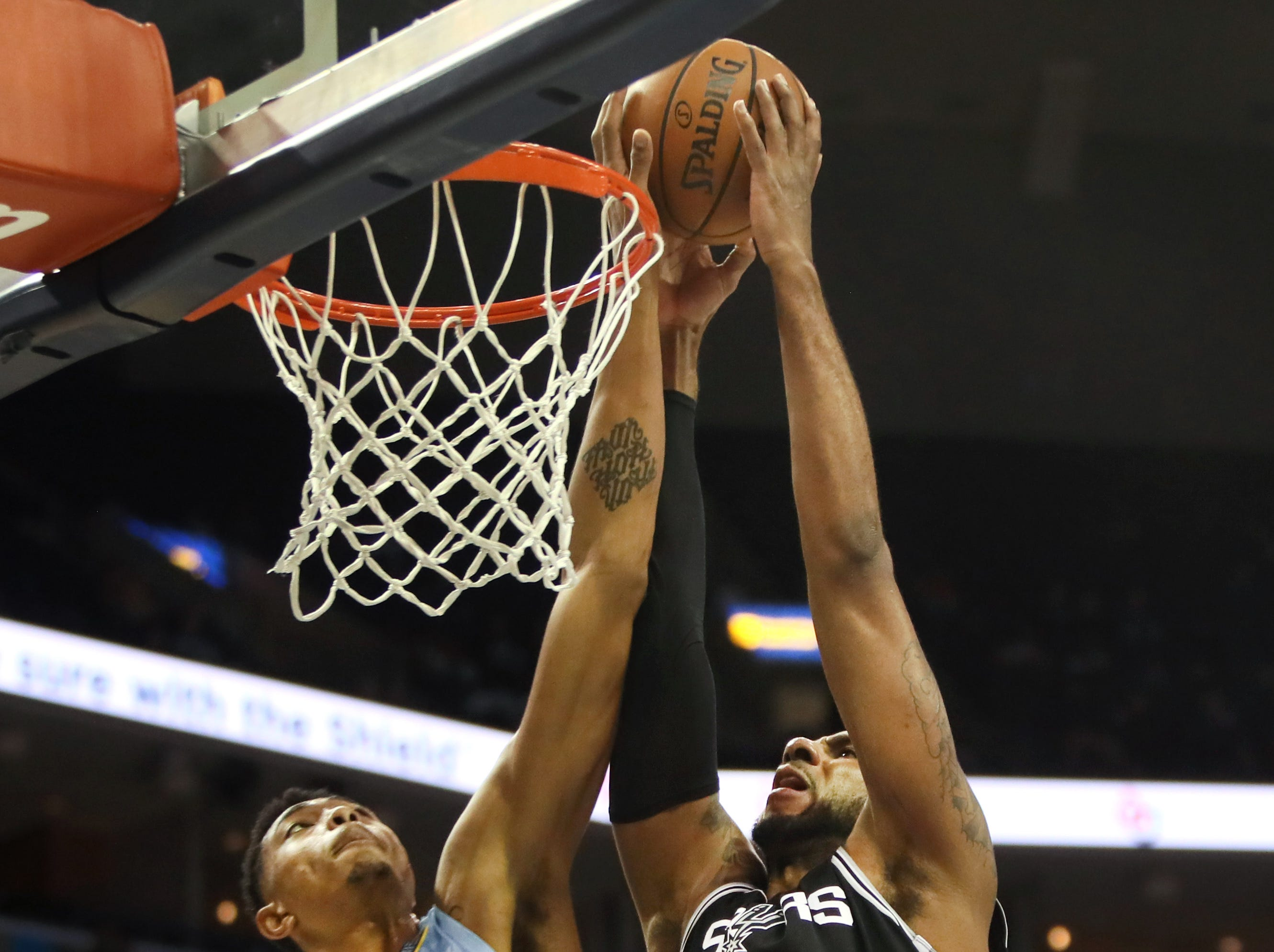 Memphis Grizzlies forward Bruno Caboclo blocks a shot against San Antonio Spurs center LaMarcus Aldridge during their game at the FEdExForum on Tuesday, Feb. 12, 2019.