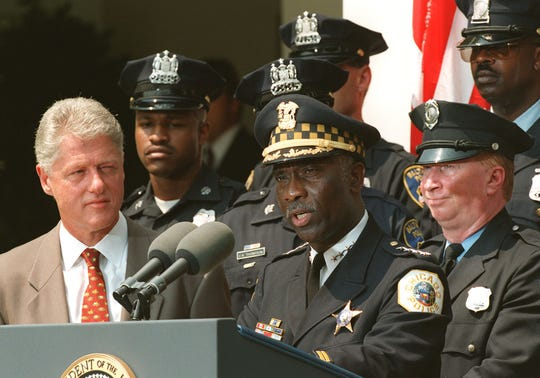 President Bill Clinton watches as Chicago Police Superintendent Terry Hiliard speaks during a ceremony at the White House in which Clinton announced a new initiative to hire more community police in high-crime neighborhoods.
