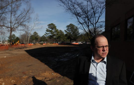 Paul Chandler, executive director of the Germantown Performing Arts Center, stands on the beginning stages of construction for The Grove, GPAC's outdoor performance venue slated to be finished next year.