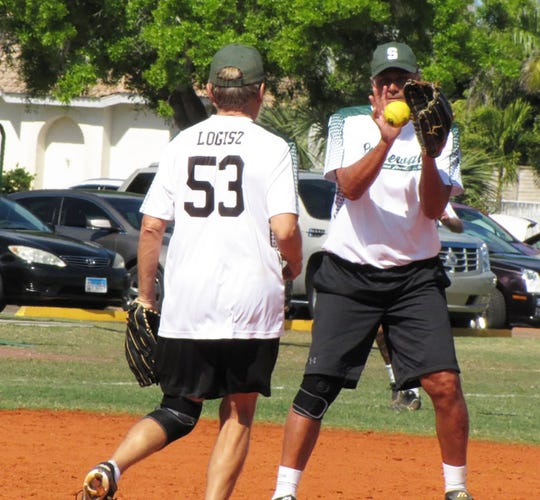 Stonewalls Joe Logisz  tosses the ball to shortstop Steve Hemberger in game versus Snook Inn.
