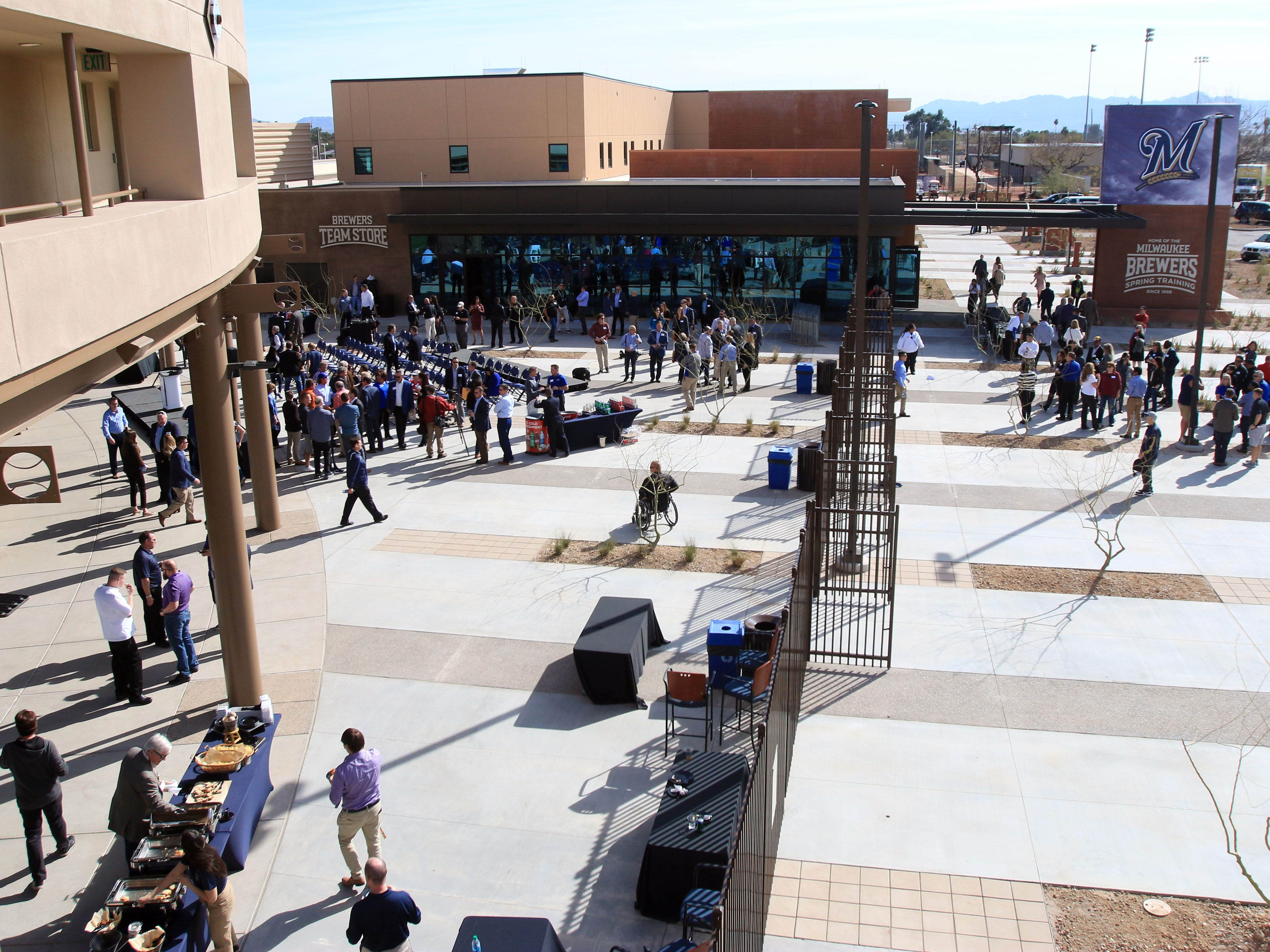 Fans gather at the Home Plate Entry Plaza at American Family Fields of Phoenix on Tuesday.