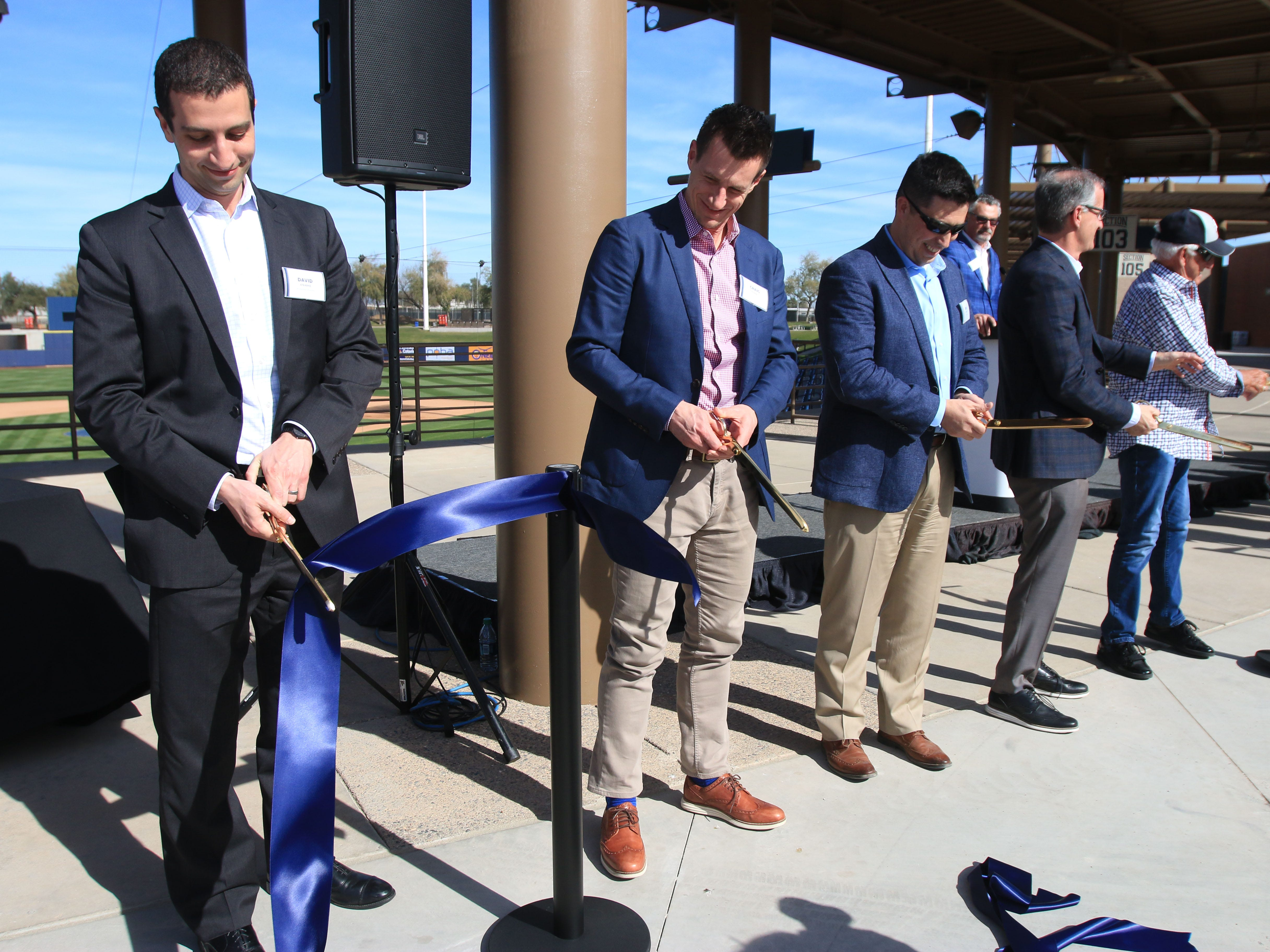 From left, Brewers general manager David Sterns, manager Craig Counsell, Ben Goetter of the Phoenix leadership team, president of business operations Rick Schlesinger and broadcaster Bob Uecker were among those helping to unveil the Milwaukee Brewers Spring Training facility named American Family Fields of Phoenix, during a ribbon-cutting ceremony on Tuesday.