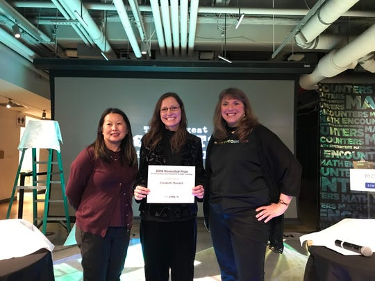 Cedarburg High School math teacher Elizabeth Masslich (center) shows off her 2018 Rosenthal Prize with Museum of Mathematics Head of Special Projects Yia Hang (left) and Museum of Mathematics Executive Director and CEO Cindy Lawrence (right) beside her. Masslich won $25,000 for a lesson plan she wrote.