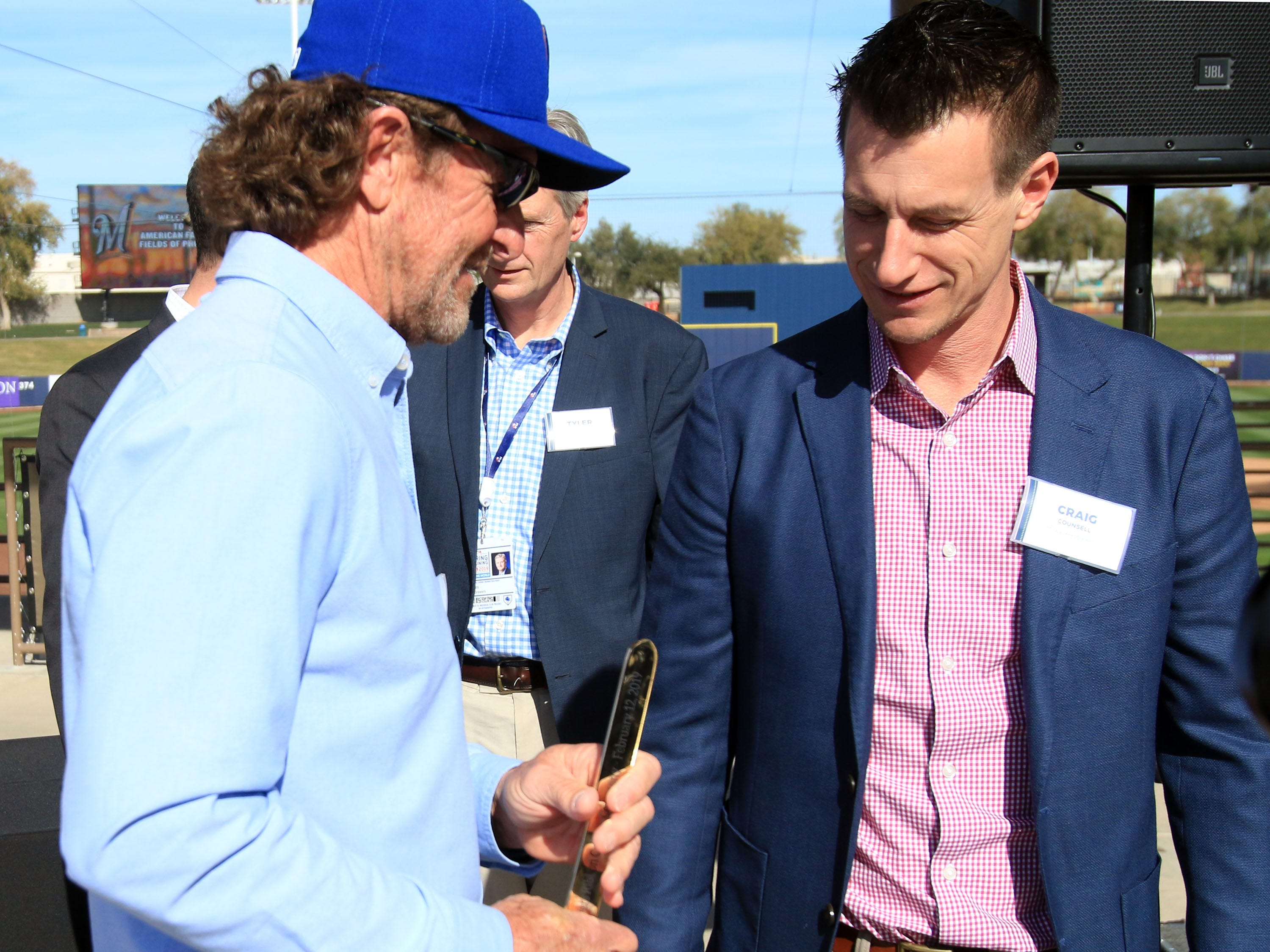 Baseball Hall-of-Famer Robin Yount, left, and Brewers manager Craig Counsell check out the gold scissors, following the ribbon-cutting ceremony.