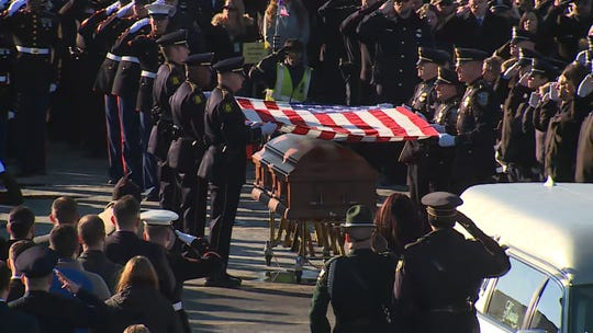 Police and military honors are performed after the funeral service for slain Milwaukee Police Officer Matthew Rittner at Oak Creek Assembly of God Church in Oak Creek.