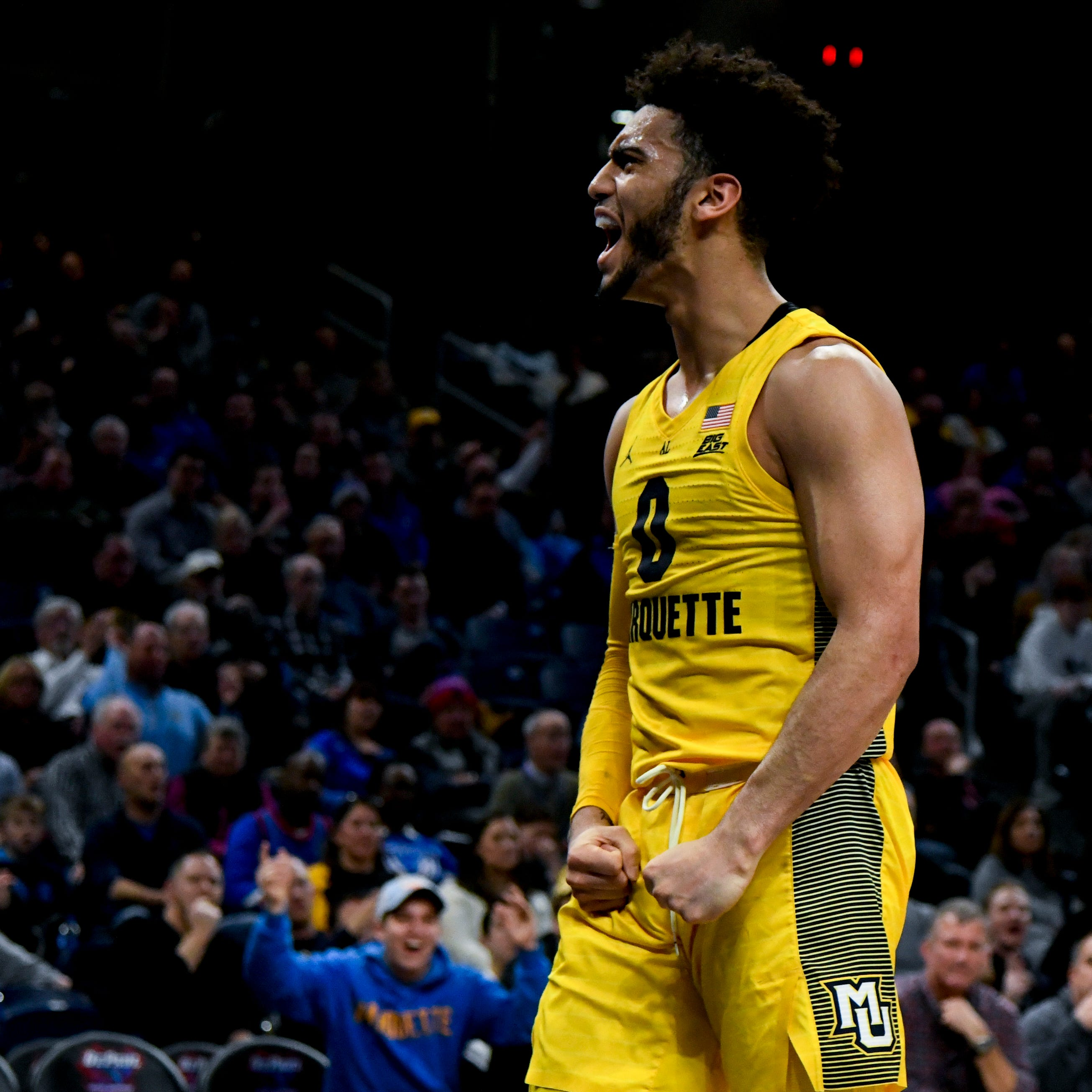 Marquette guard Markus Howard celebrates after a...