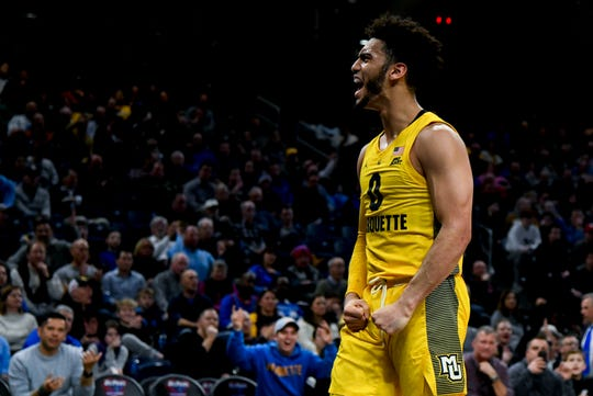 Marquette guard Markus Howard celebrates after a basket.