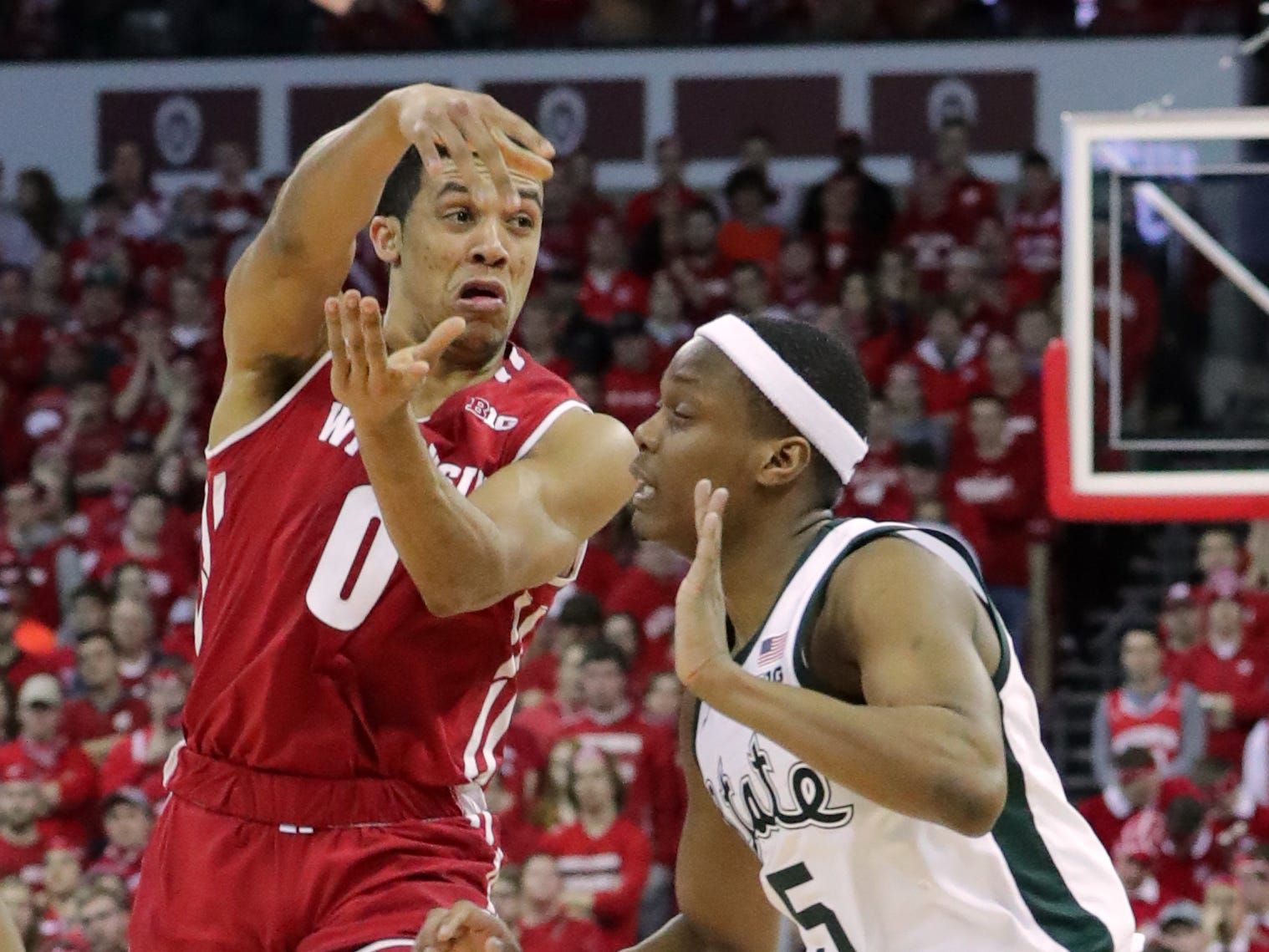 Wisconsin's D'Mitrik Trice finds an open man while being guarded by Cassius Winston.