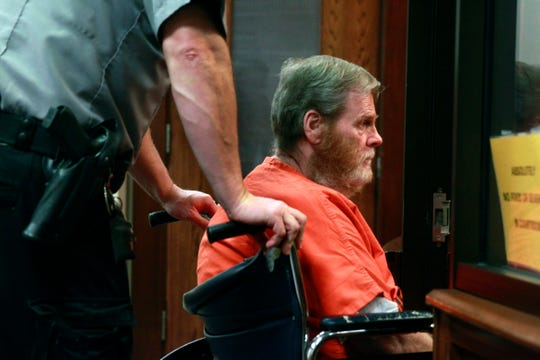 William Gallagher, right, is brought into court for his sentencing in Judge David Hansher's court room Wednesday. Gallagher is a career criminal who tried to rob a bank just so he could be sent back to prison.