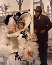 "Eliza Doolittle (Audrey Hepburn) and Prof. Henry Higgins (Rex Harrison) check out the competition at Ascot in a scene from ""My Fair Lady."""
