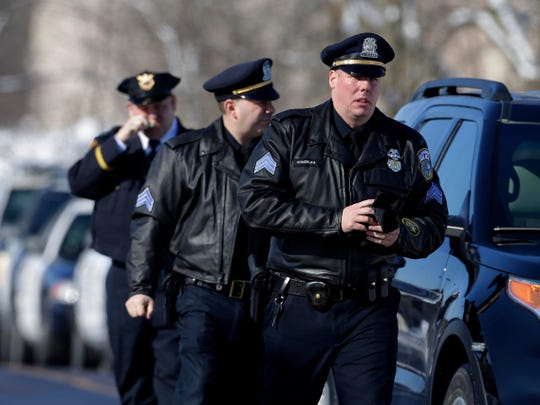 Milwaukee police officers arrive Wednesday at Oak Creek Assembly of God Church for the public visitation for slain Milwaukee Police Officer Matthew Rittner. Funeral services for Rittner were also being held at the church.