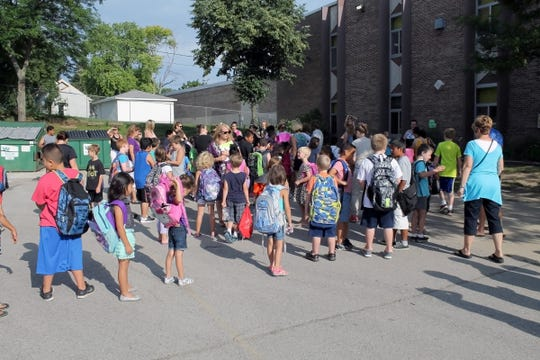 Students and parents line up outside of Blair Elementary School before summer school classes in July 2016. As part of a cost-cutting move, the Waukesha School Board has approved of a consolidation plan that will close Blair and shift its students to Hawthorne and Lowell elementary schools.