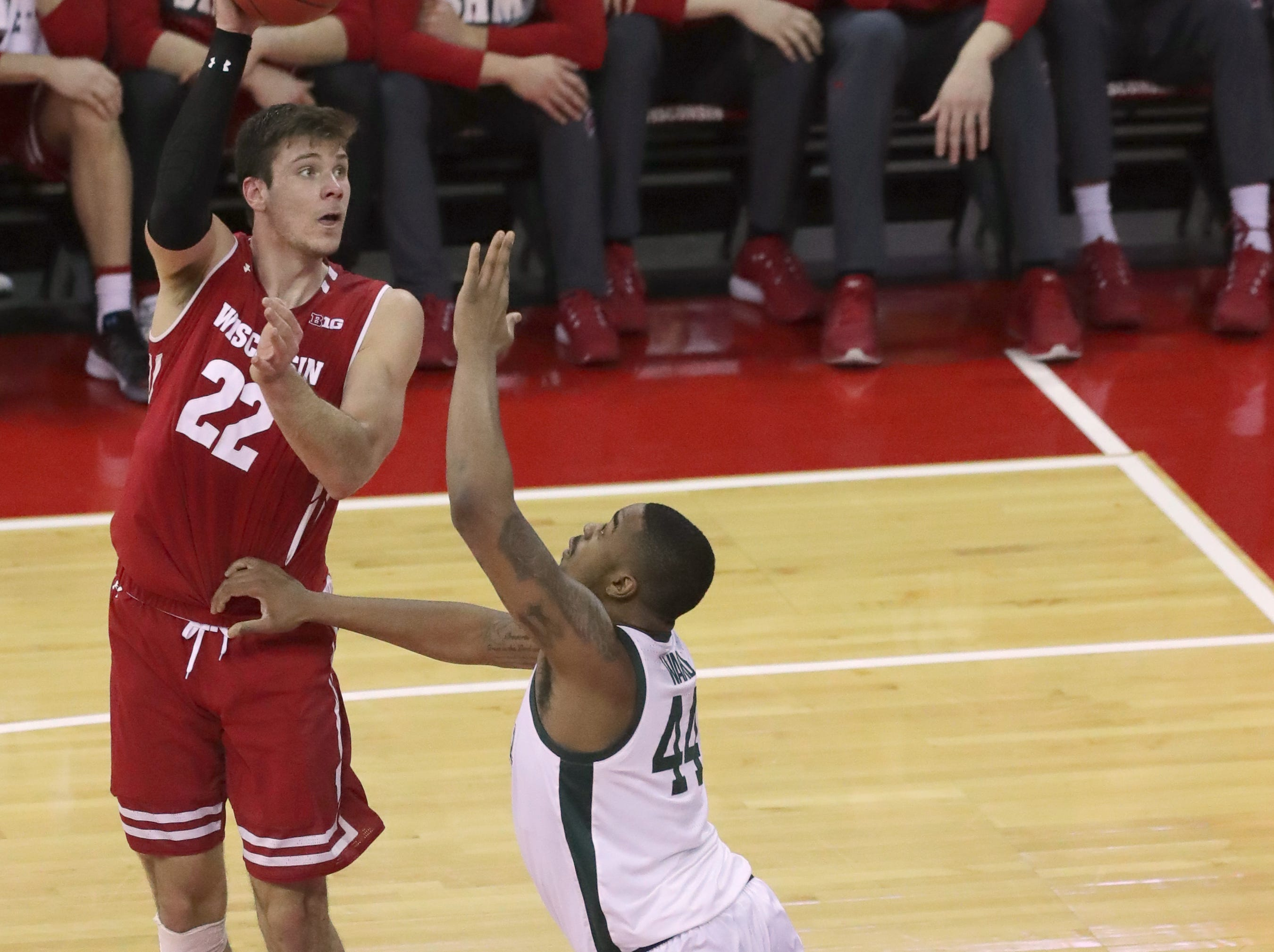 Wisconsin forward Ethan Happ shoots over Michigan State forward Nick Ward.