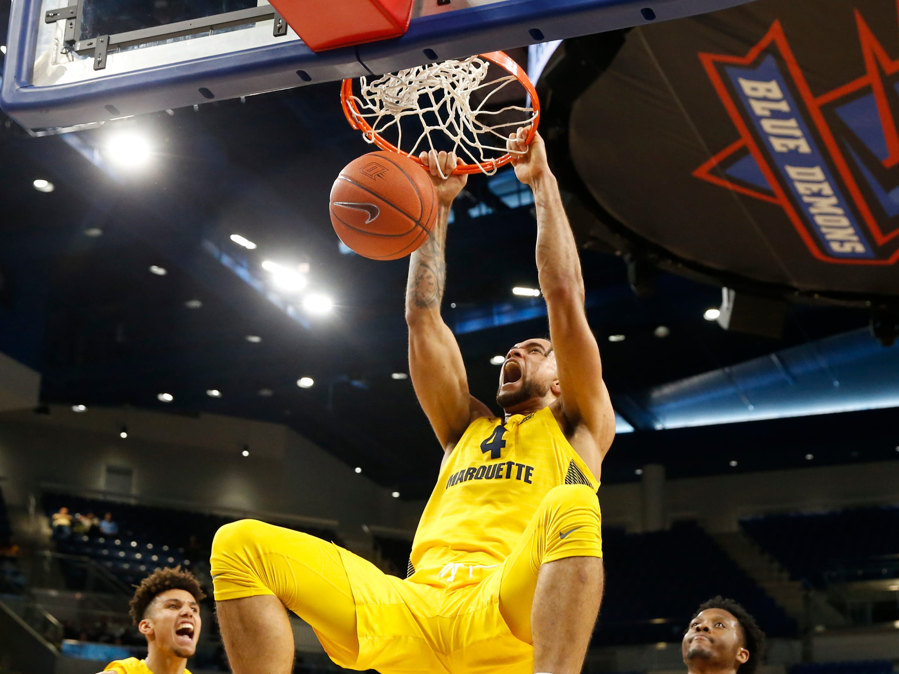 Marquette Golden Eagles forward Theo John finishes a dunk