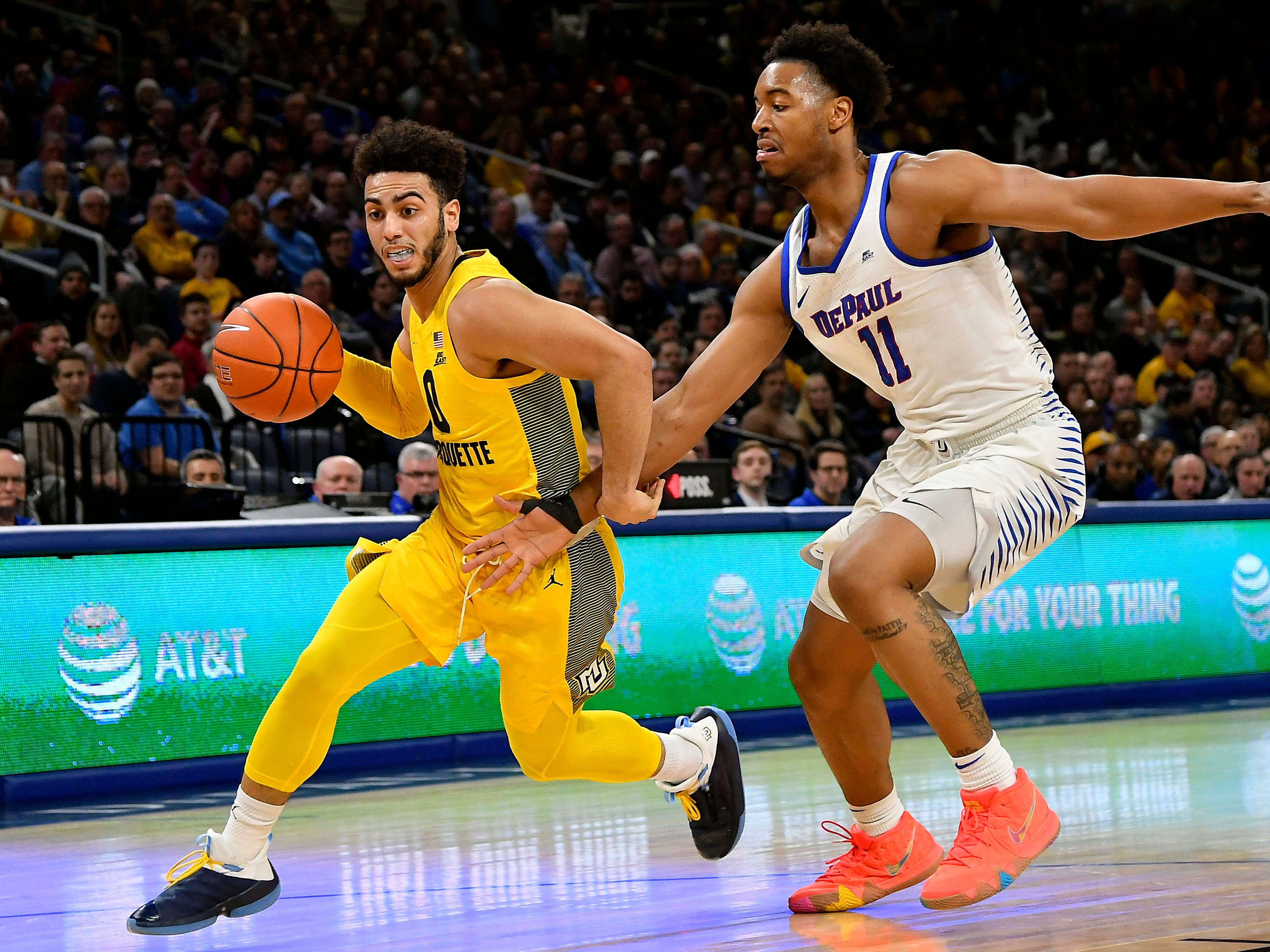 Marquette's Markus Howard tries to turn the corner on DePaul's Eli Cain.