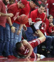 Wisconsin guard Brad Davison hits the deck while chasing a loose ball.