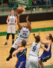 Cotter's Samantha Sanchez goes up for two against Decatur on Tuesday night in the 2A-1 District Tournament.