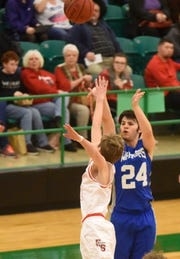 Cotter's Dylan Dwyer launches a 3-point attempt against Eureka Springs on Tuesday night.