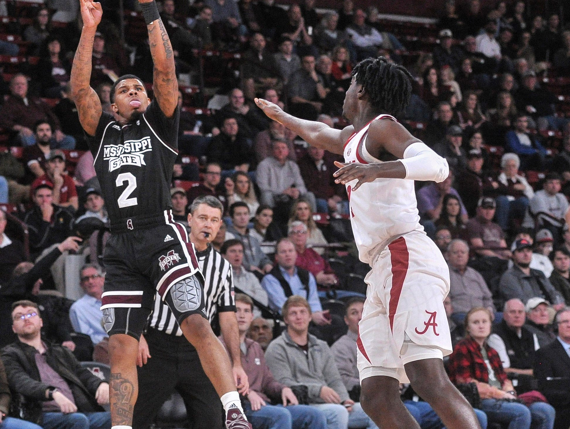 Feb 12, 2019; Starkville, MS, USA; Mississippi State Bulldogs guard Lamar Peters (2) shoots against Alabama Crimson Tide guard Kira Lewis Jr. (2) during the first half at Humphrey Coliseum. Mandatory Credit: Justin Ford-USA TODAY Sports