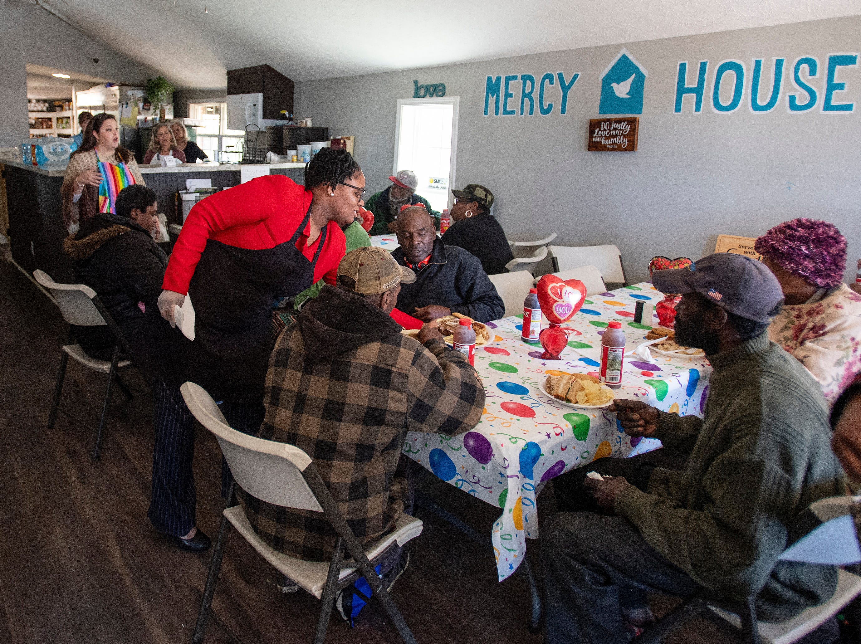 Volunteers help feed members of the community at Mercy House in Montgomery, Ala., on Wednesday February 13, 2019.