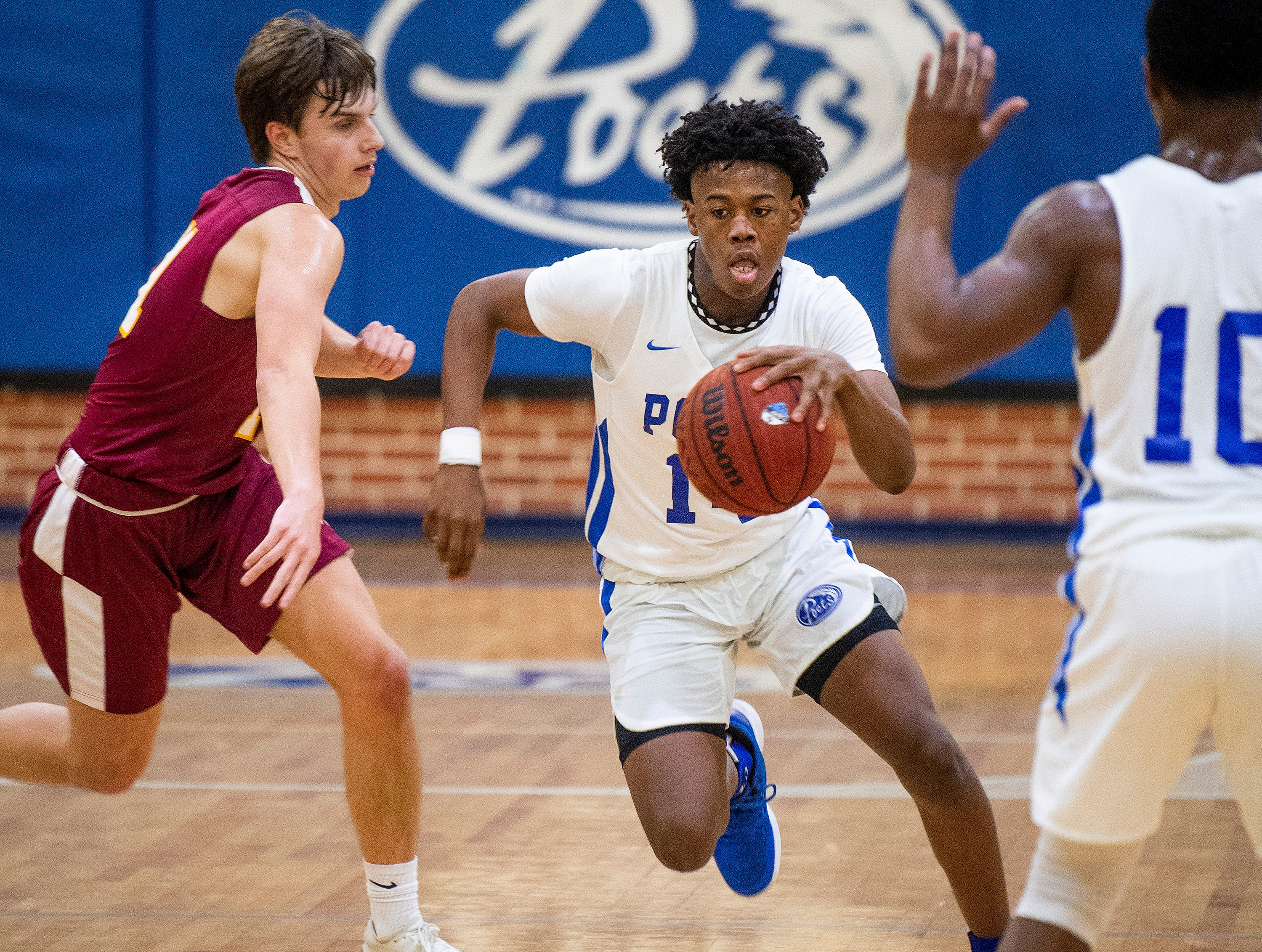 Lanier's Elijah White (14) against Northview at the Lanier campus in Montgomery, Ala., on Tuesday February 12, 2019.