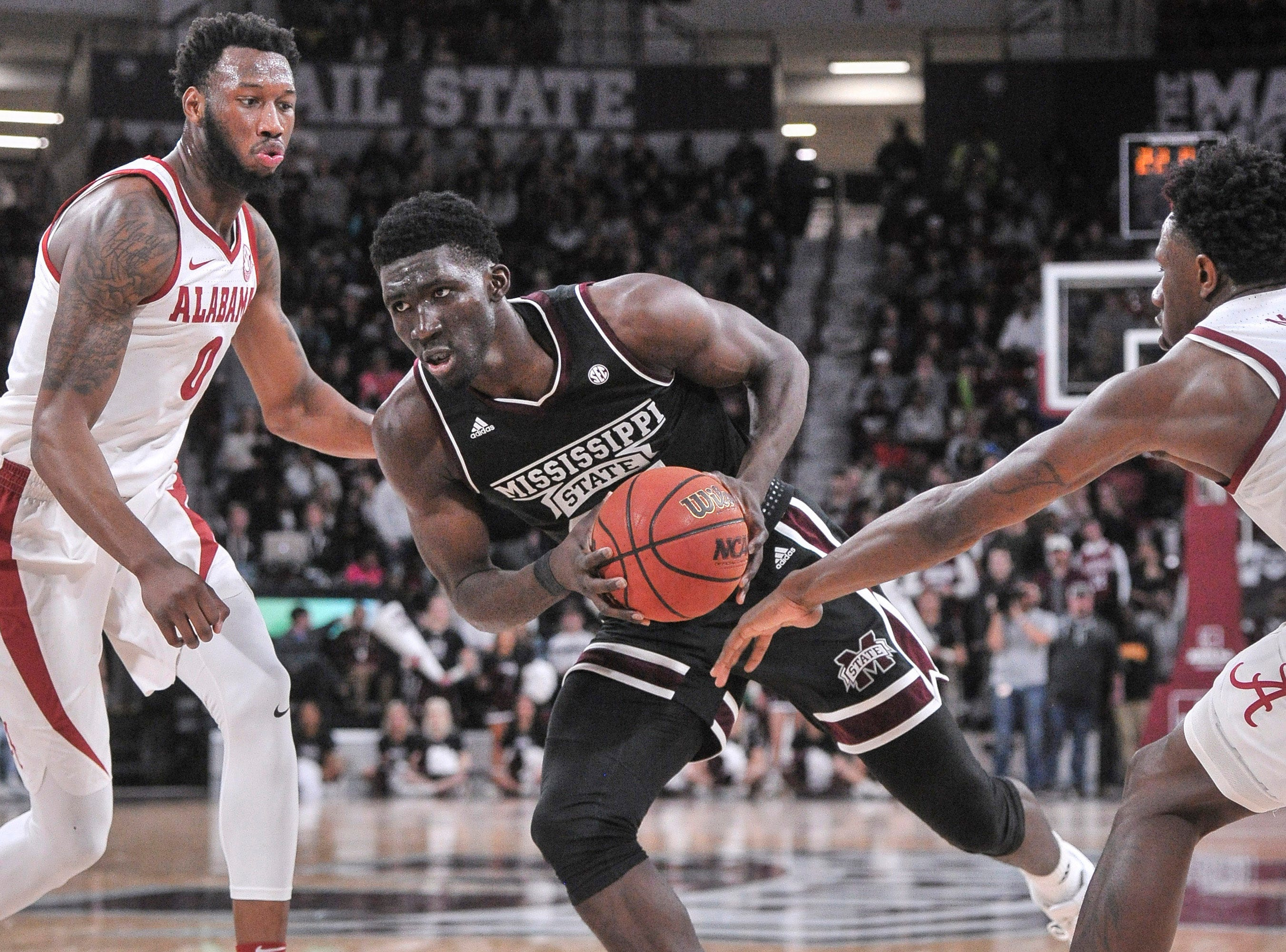 Feb 12, 2019; Starkville, MS, USA; Mississippi State Bulldogs forward Abdul Ado (24) goes to the basket against Alabama Crimson Tide forward Donta Hall (0) during the first half at Humphrey Coliseum. Mandatory Credit: Justin Ford-USA TODAY Sports