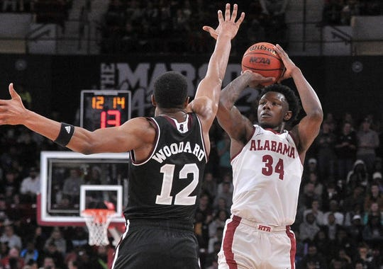 Feb 12, 2019; Starkville, MS, USA; Alabama Crimson Tide guard Tevin Mack (34) shoots the ball over Mississippi State Bulldogs guard Robert Woodard (12) during the second half at Humphrey Coliseum. Mandatory Credit: Justin Ford-USA TODAY Sports