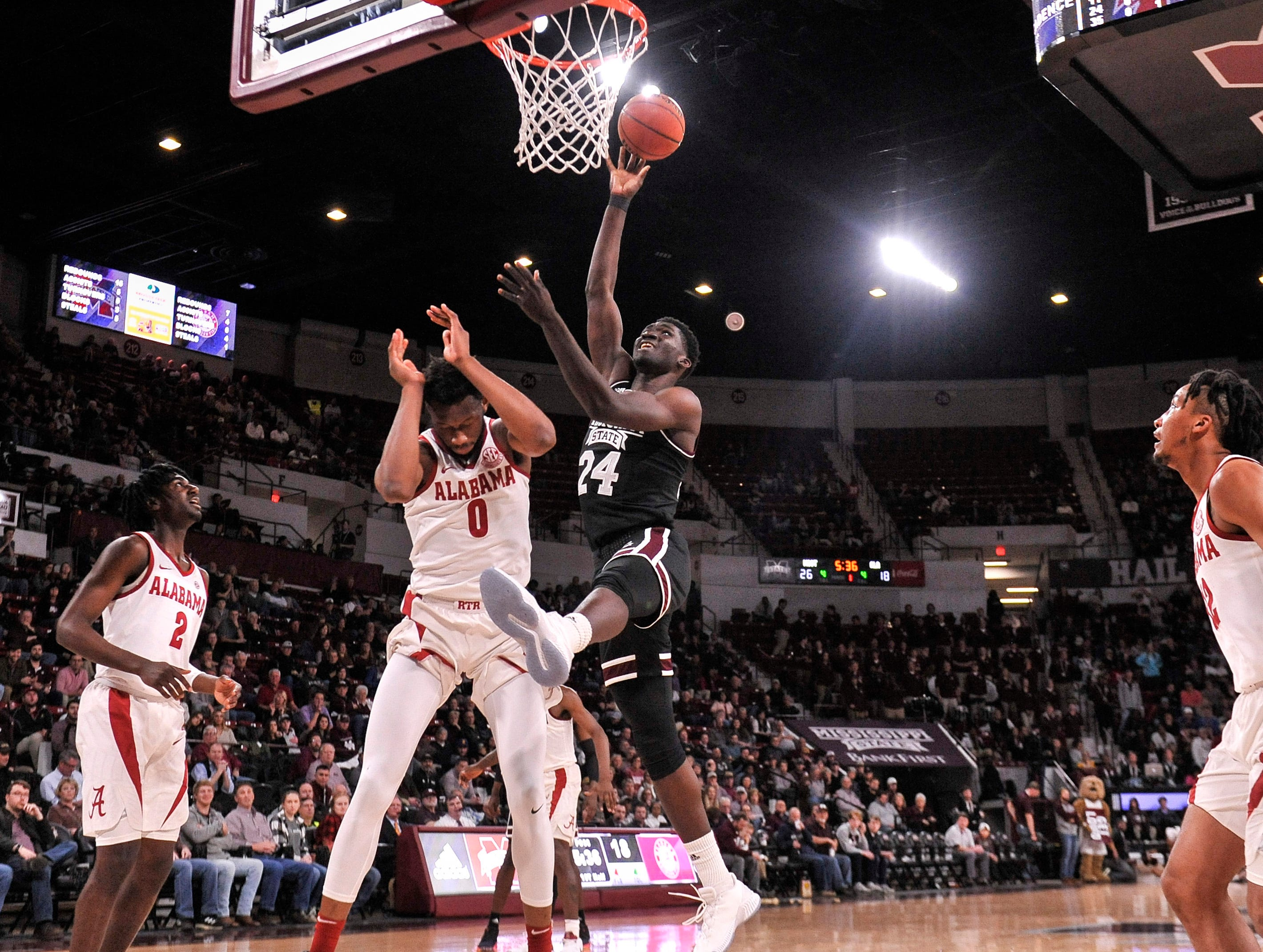 Feb 12, 2019; Starkville, MS, USA; Mississippi State Bulldogs forward Abdul Ado (24) shoots the ball past Alabama Crimson Tide forward Donta Hall (0) during the first half at Humphrey Coliseum. Mandatory Credit: Justin Ford-USA TODAY Sports