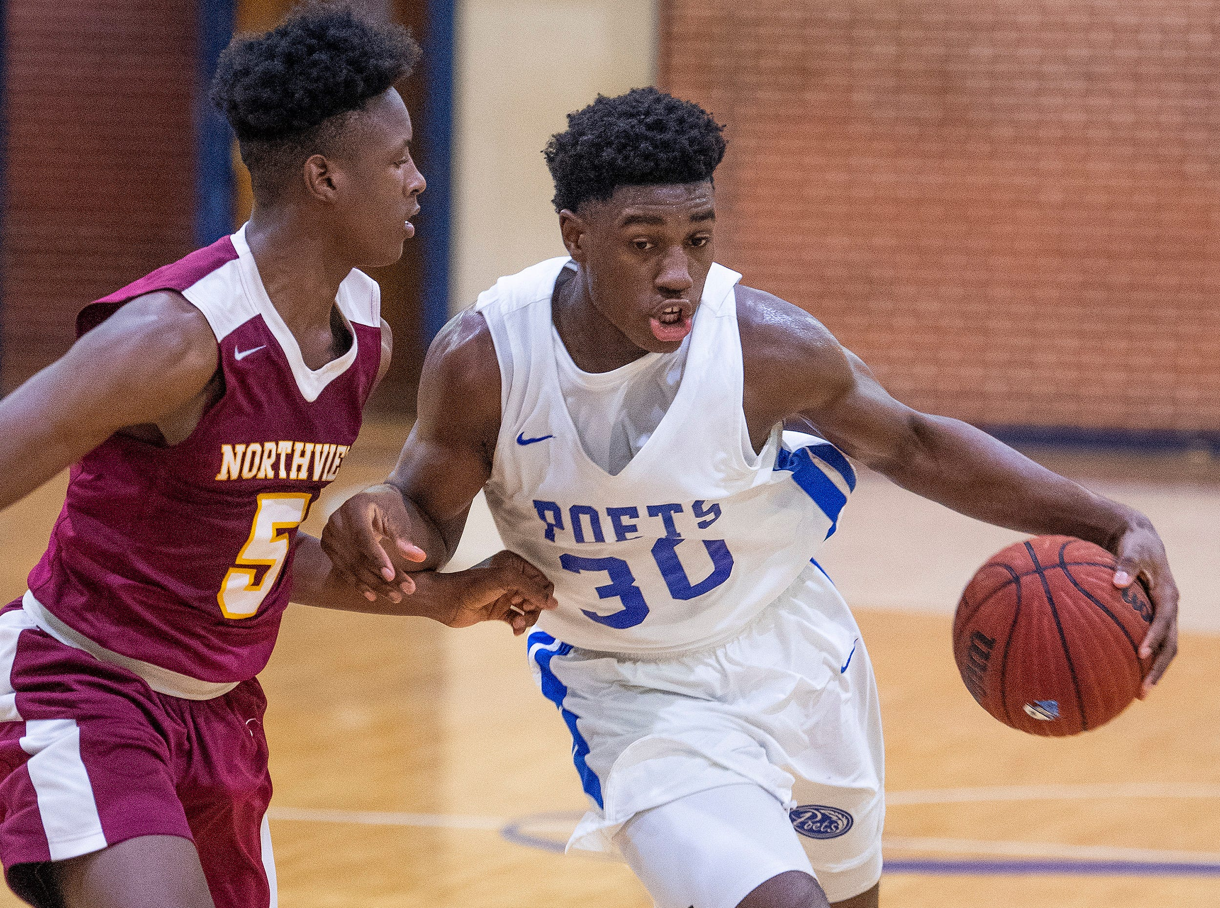 Lanier's Rongie Gordon (30) drives by Northview's Christopher Shakleford (5) at the Lanier campus in Montgomery, Ala., on Tuesday February 12, 2019.