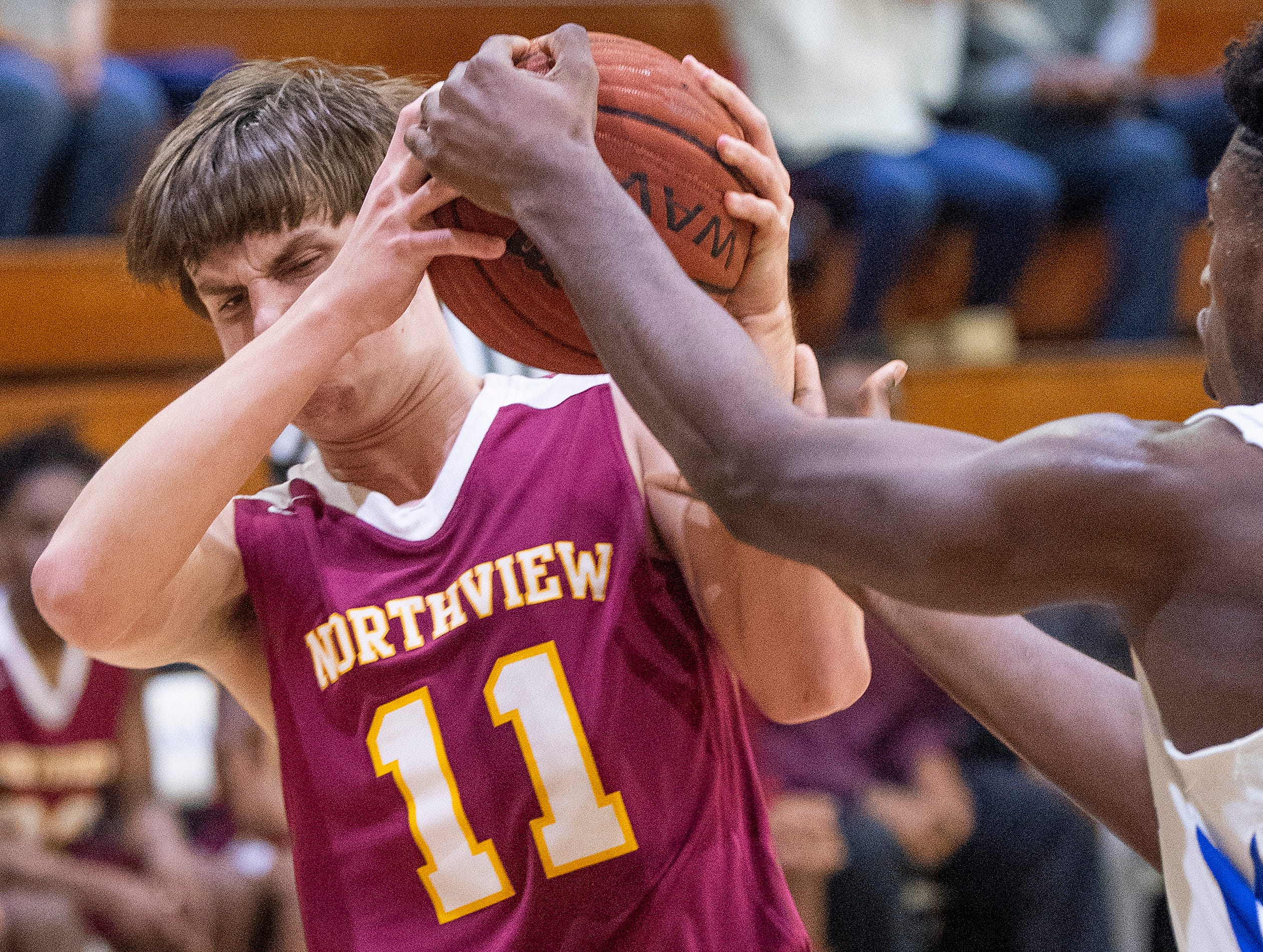 Northview's Harrison Holland (11) and Lanier's Rongie Gordon (30) fight for a loose ball at the Lanier campus in Montgomery, Ala., on Tuesday February 12, 2019.