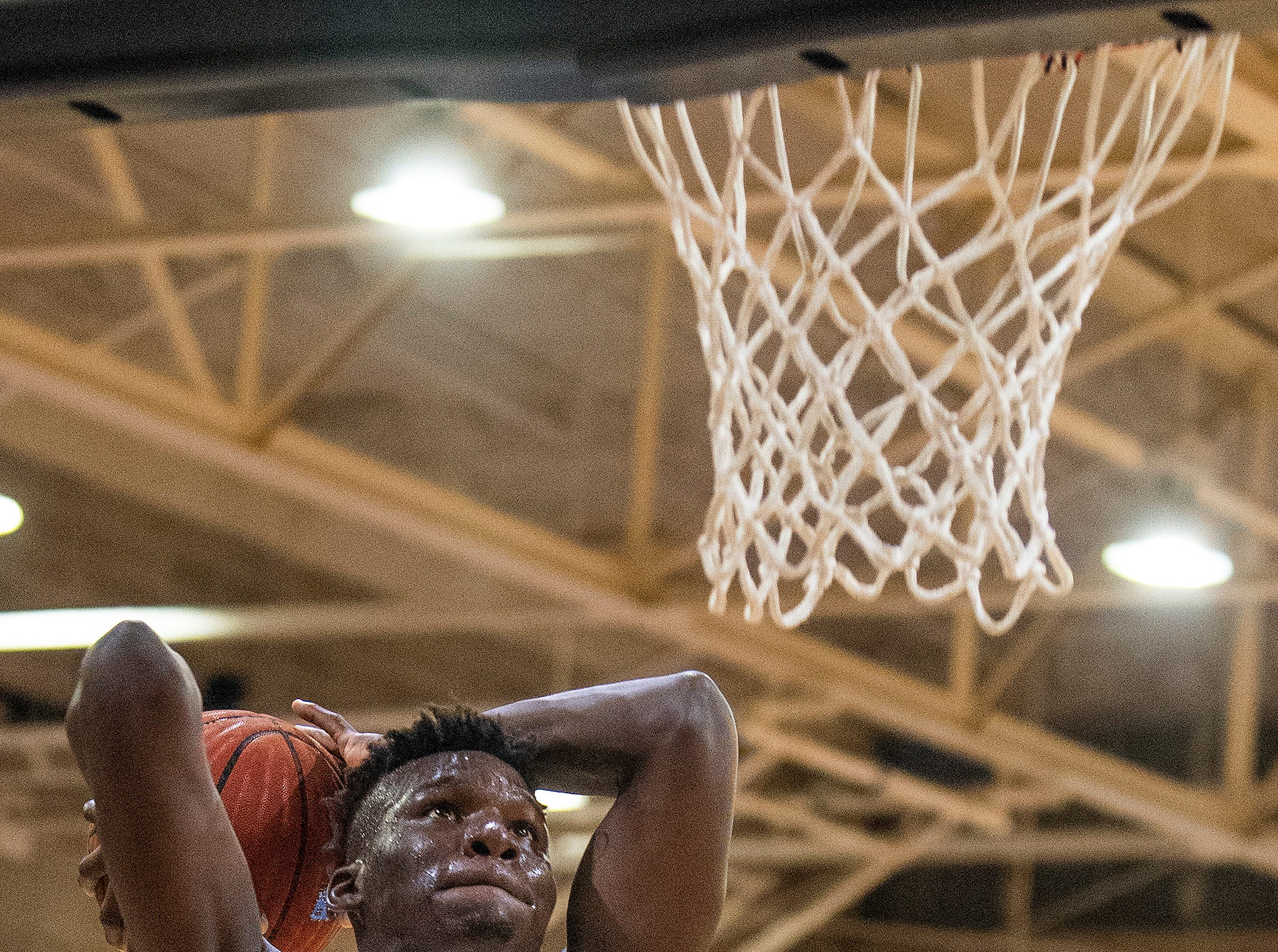 Lanier's Antwan Burnett (11) dunks against Northview at the Lanier campus in Montgomery, Ala., on Tuesday February 12, 2019.