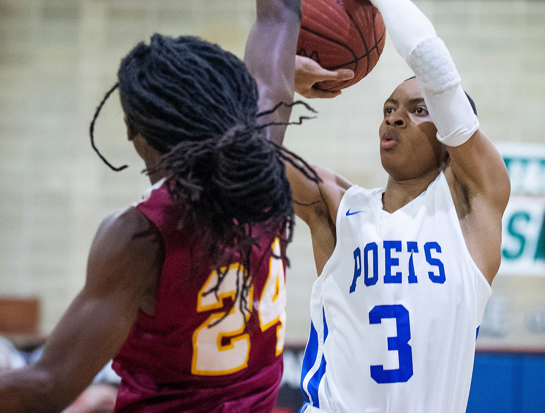 Lanier's Malik Stinson (3) shoots against Northview at the Lanier campus in Montgomery, Ala., on Tuesday February 12, 2019.