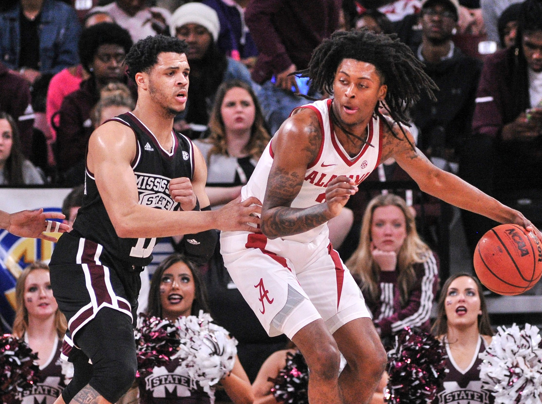 Feb 12, 2019; Starkville, MS, USA; Alabama Crimson Tide guard John Petty (23) handles the ball against Mississippi State Bulldogs guard Quinndary Weatherspoon (11) during the first half at Humphrey Coliseum. Mandatory Credit: Justin Ford-USA TODAY Sports
