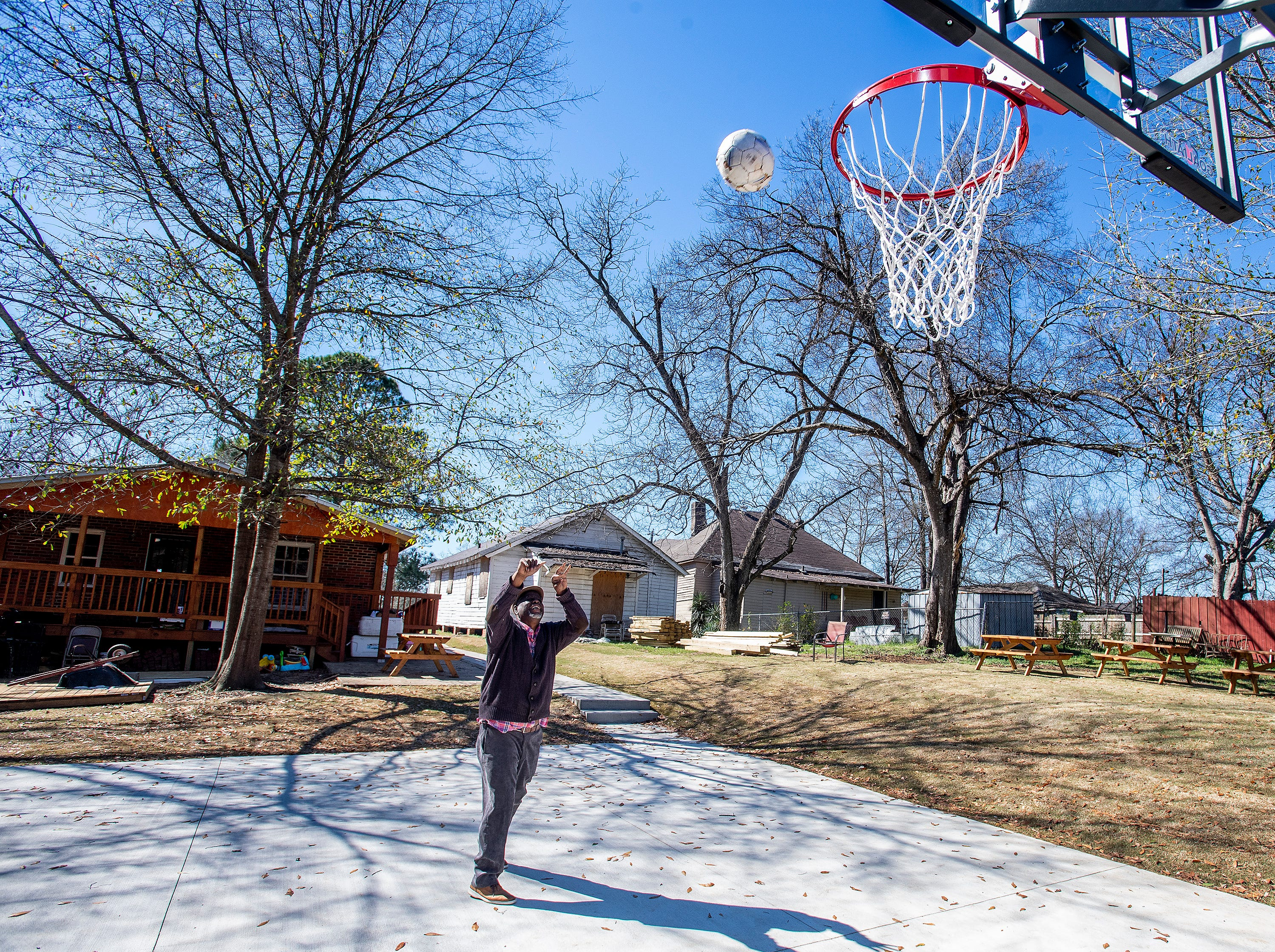 Ken Austin, executive director of the Mercy House and pastor at New Walk of Life Church, shows off his new basketball court behind Mercy House in Montgomery, Ala., on Wednesday February 13, 2019.